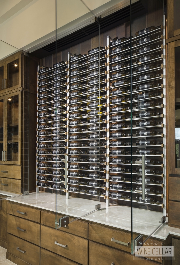 wine wall cabinets with open glass doors displaying wine at Verde River