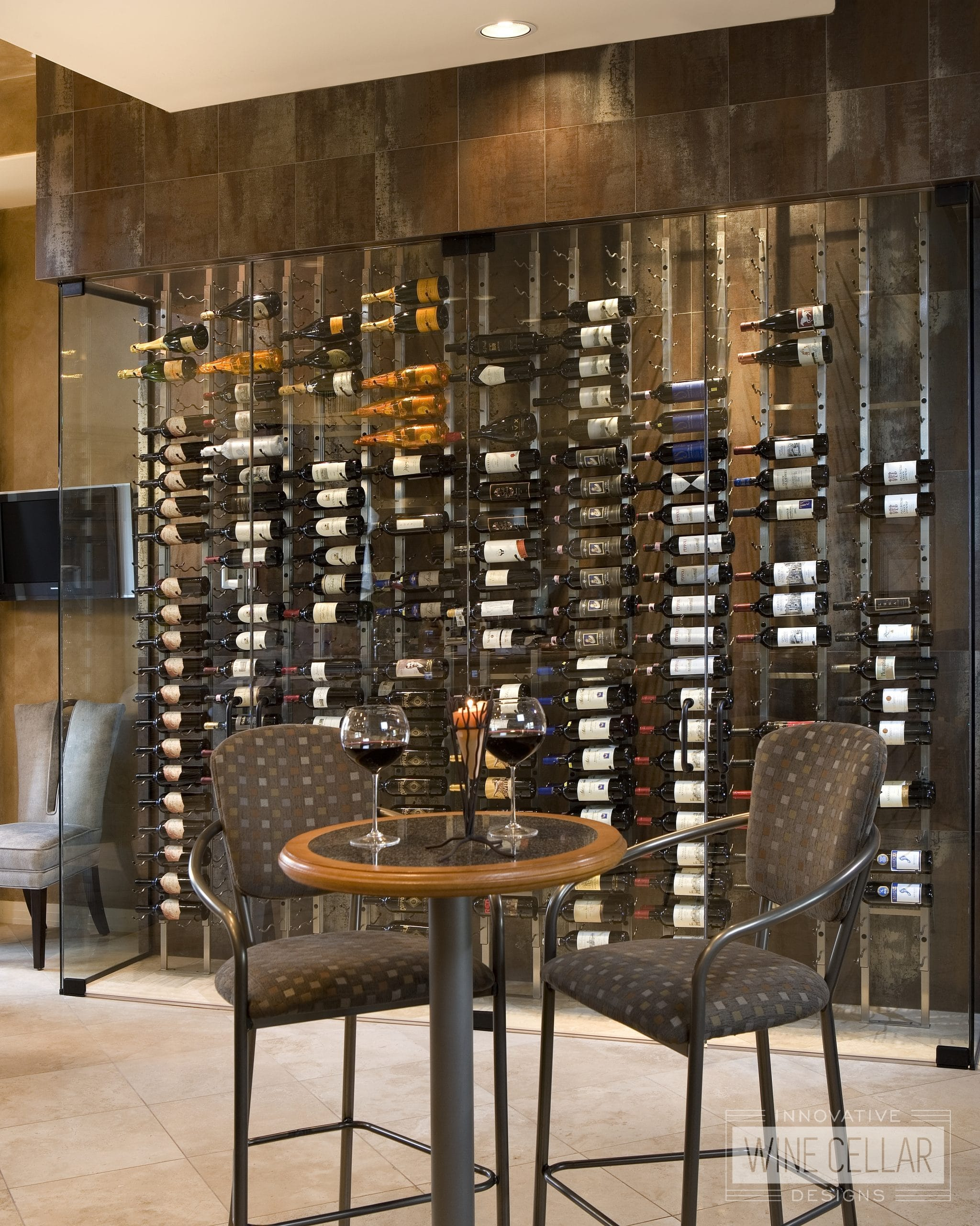 Modern single wall wine storage enclosed with glass doors for temperature control.